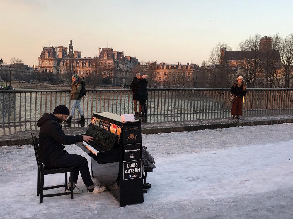 Dedicated piano player on Pont St-Louis, the bridge between Ile de la Cité and Ile St-Louis.