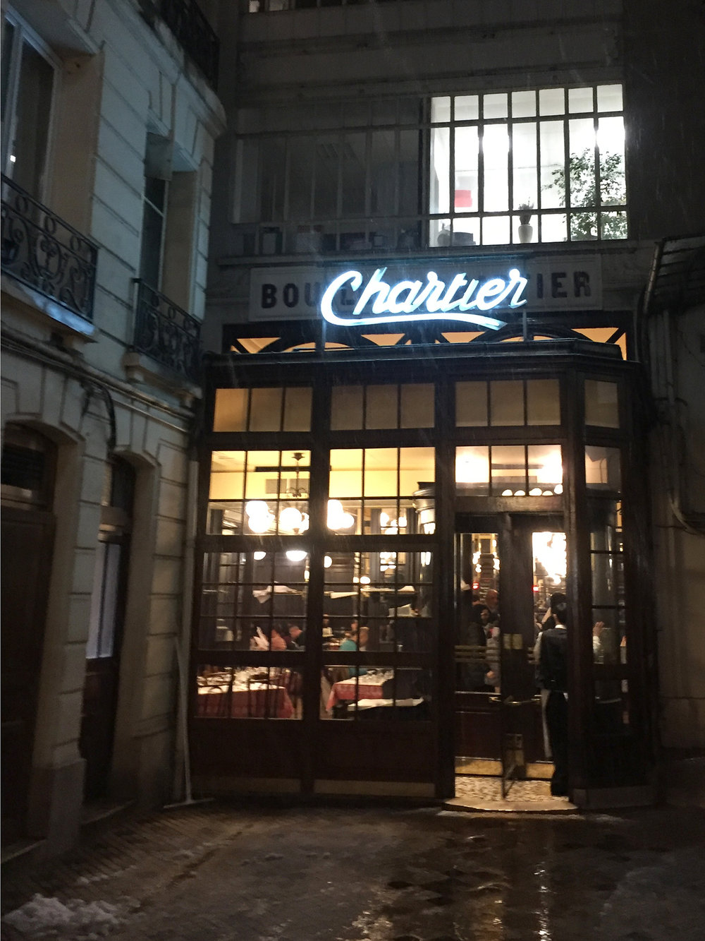 From 7 rue du Faubourg Montmartre, enter the stone courtyard to reach the revolving door entrance to Bouillon Chartier.