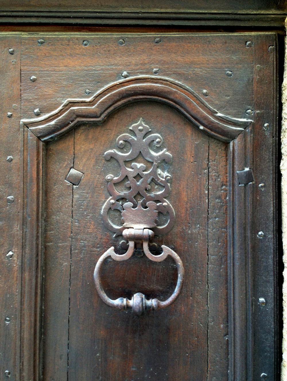 The buckle style door knocker became very popular in the 18th century