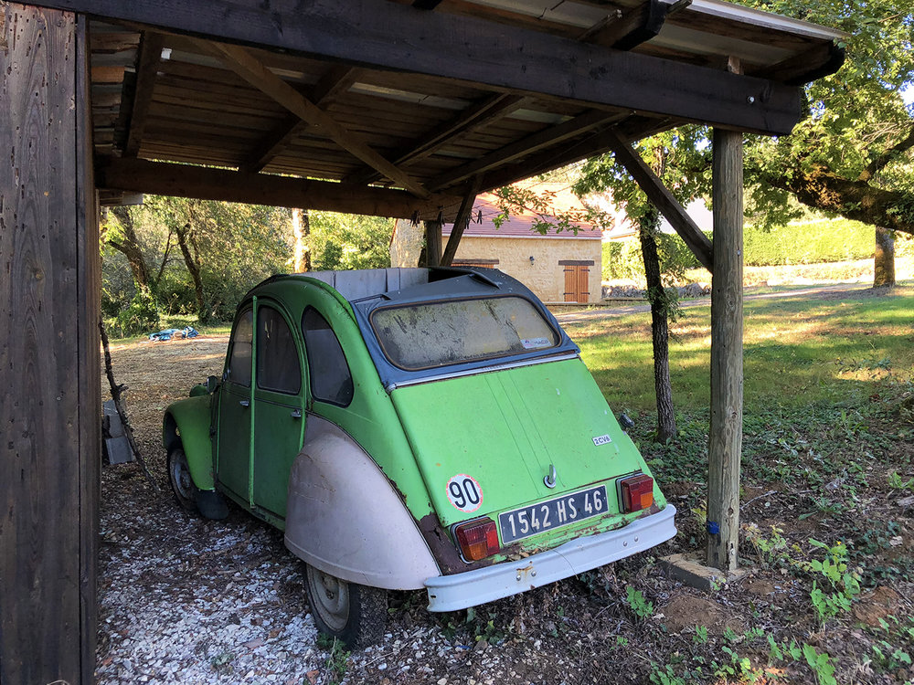 A bright green 2 CV sits on my neighbor's property, less than 300 feet from my office. It would need a lot of TLC to hit the asphalt!