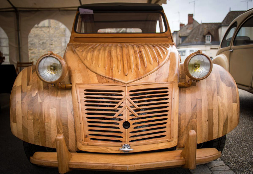 Michel Robillart, a professional woodworker, made the news last year with his wooden 2 CV. Photo credit: Guillaume Souvant/AFP.