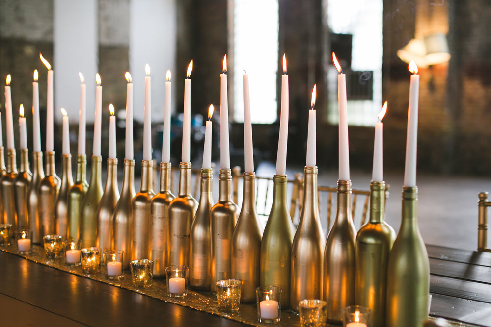 we sprayed over 200 wine bottles different shades of gold