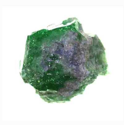Green Tsavorite Garnet with Violet Tanzanite (Zoisite) on the outer edge (Photo: B. Olivier). Destruction of the Tsavorite to form Tanzanite.