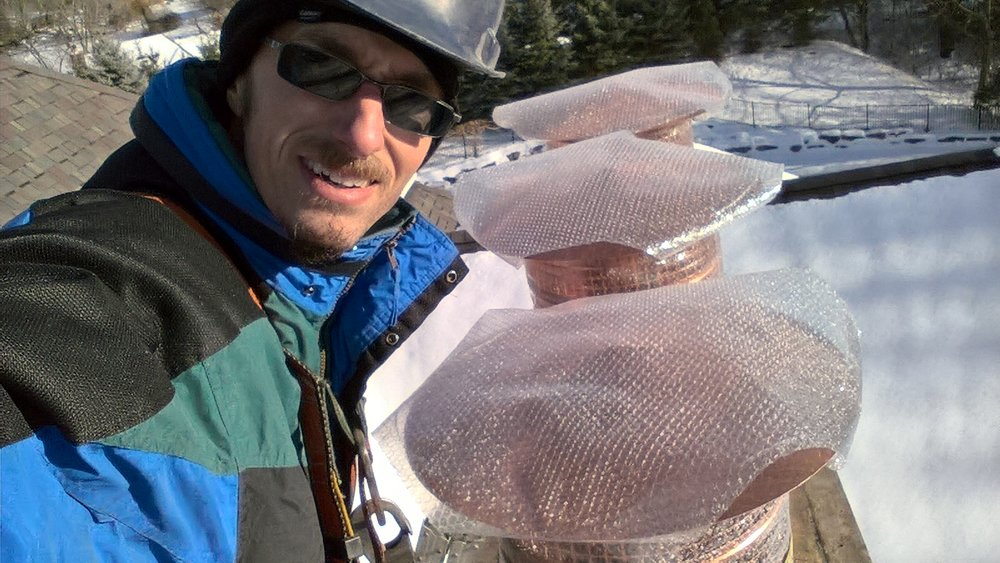 Copper chimney caps with bubble wrap around.jpg