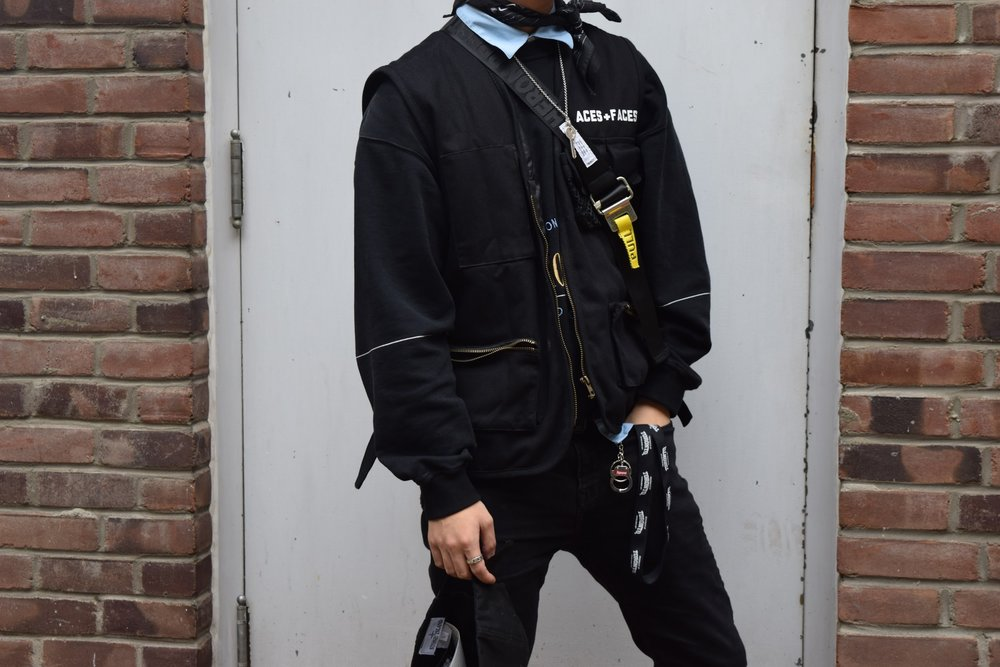 Crewneck:  Balenciaga Homme Collection , Tech wear-inspired Vest:  Places + Faces