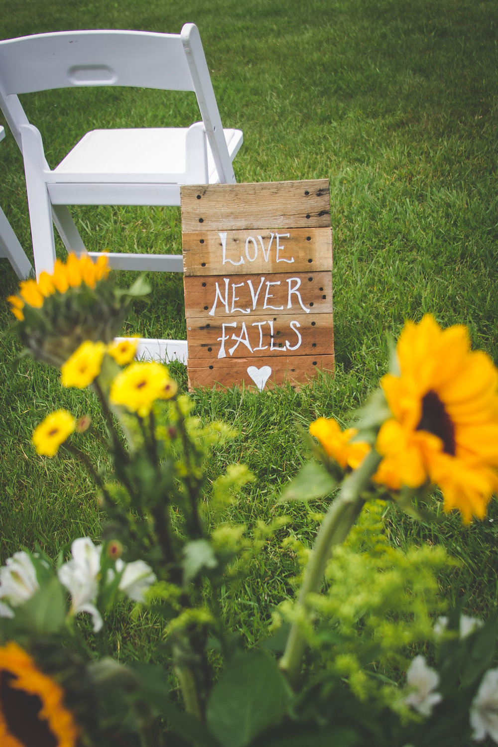 These signs lined the aisle for the ceremony.