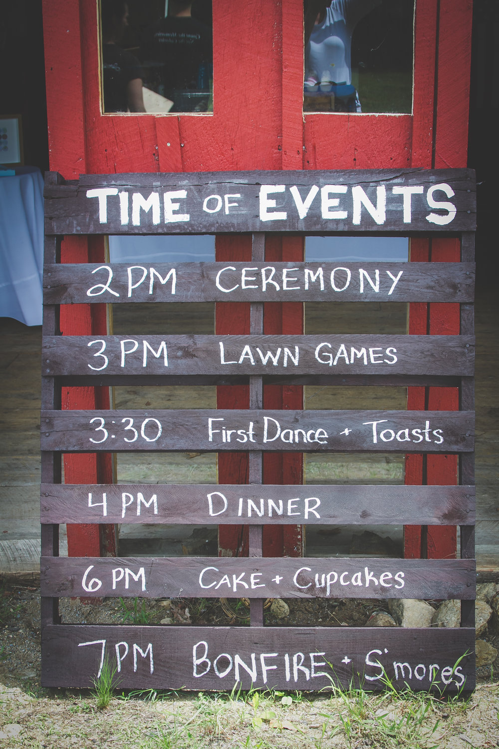 This timeline of events outlines plans for the wedding.  This schedule was hand panted onto a pallet to create a rustic touch.