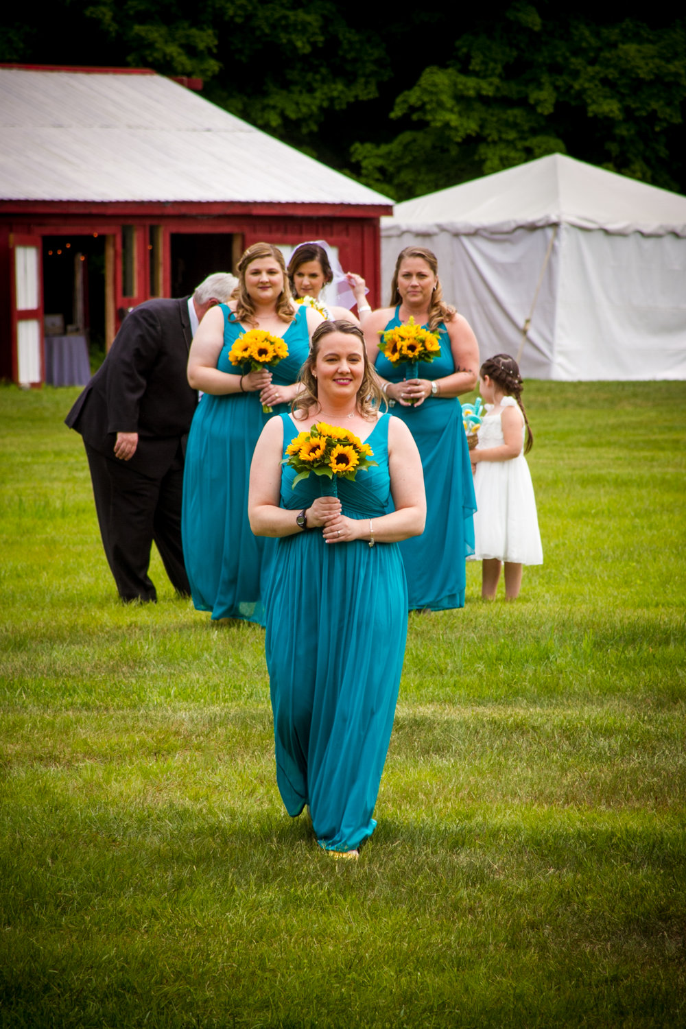 The bridesmaids begin their walk down the aisle.  The Bride is waiting in the back to begin her entrance.