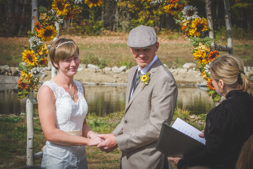 Elissa and Scott chose to get married before the pond.  They have a sunflower adorned birch archway as well.