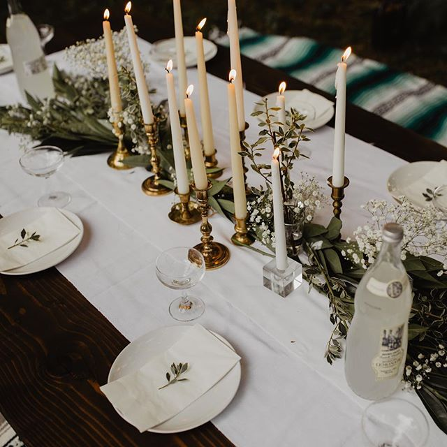 QUESTION - is it too chilly to host another outside gathering? . side note: you don't have to break the bank to create a beautiful tablescape like this one! i thrifted almost EVERYTHING (except my white plates) all the candle sticks, all the candle holders, and even those darling glasses. i picked up a couple bunches of greens + baby's breath at @traderjoes cause they have the best prices. the table runner was also thrifted white fabric for $0.50 . . . . . #darlingmagazine #blogger #lifestyleblogger #midwestblogger #midwestbloggers #michiganblogger  #grandrapids #grandrapidsmi #downtowngr #grandrapidsdaily #westmichigan #michigan #michigrammers #thehappinessproject #liveauthentically #liveauthentic  #travelblogger #travel #livesimply #tablesetting #tablescapes #dinnerparty #livefolk #outdoors #lookslikefilm