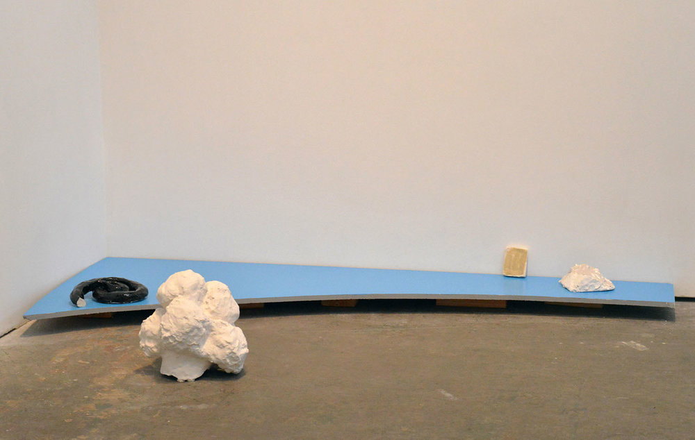 "Untitled Floor Piece , 2014 glazed porcelain, glazed and painted ceramic, latex house paint, MDF, acrylic paint 3.5"" x 62"" x 26"""