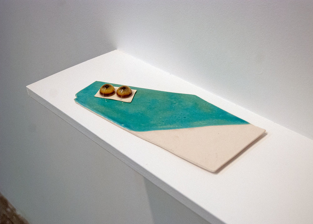 A place where you buy things for sculpture that has glass eyes,  2014 glazed porcelain and glass eyes, .75 x 11 x 5.25 inches