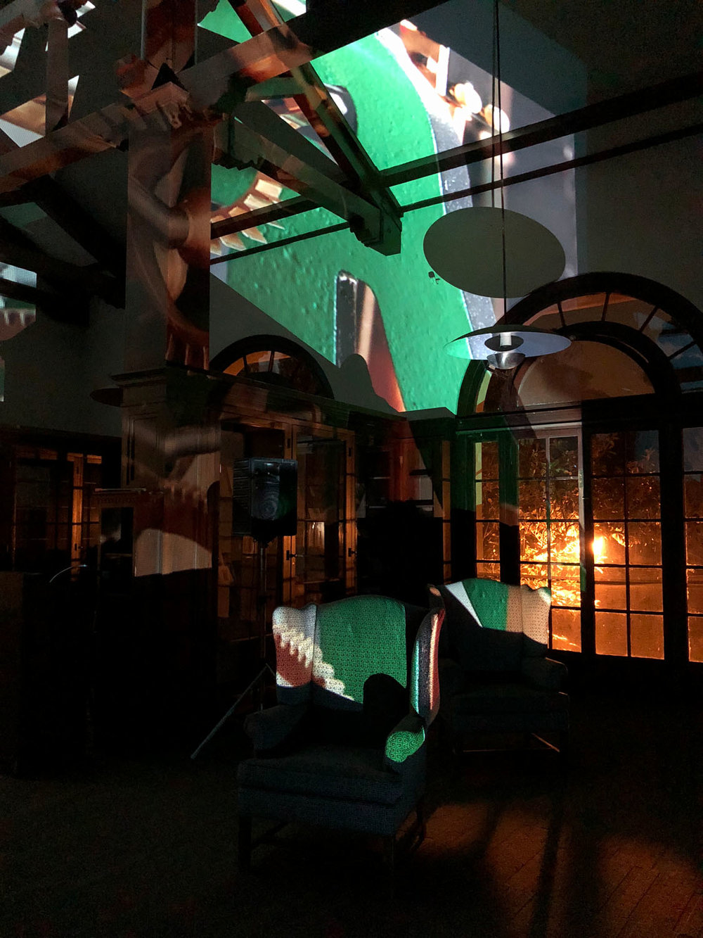 The Bender Room , an evening of new musical works by Kris Force, Brendan Glasson, and Coconut, featuring handmade instruments and video projection by Rebeca Bollinger, performed in the Mills College Bender Room—formerly part of the Margaret Carnegie Library designed by architect Julia Morgan.   Clock Tock Tick Too in Green , 2018, digital video projection, 4 minute loop with sound, size variable
