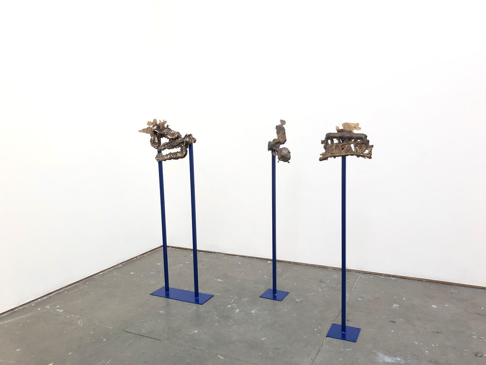 Three bronze sculptures as instruments , 2018 L-R:  The Line of History ,  Throat and Ear ,  Stain Backwards , bronze, painted steel, size variable
