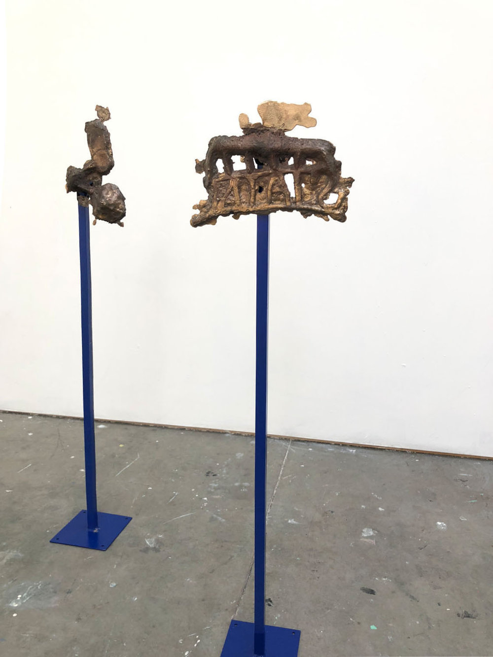Throat and Ear  (instrument) ,  2018, bronze, painted steel, 45 x 10 x 12 inches  Stain Traveling Backwards  (instrument) ,  2018, bronze, painted steel, 46 x 13 x 12 inches