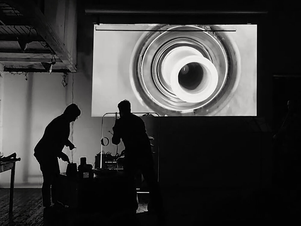 Vases and Hallucinations  (detail from performance), 2015, 5-minute silent video with live sound score featuring Scott Hewicker on pot lids, Rebeca Bollinger playing ceramics and Steven Seidenberg on Japanese shakuhachi flute