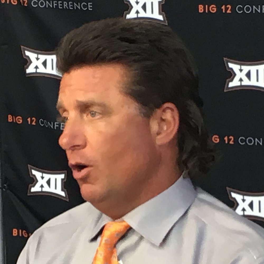 Oklahoma State head football coach, Mike Gundy, has a special phone on his desk that calls God. Photo by Bobak Ha'Eri [CC BY 3.0  (https://creativecommons.org/licenses/by/3.0)], from Wikimedia Commons