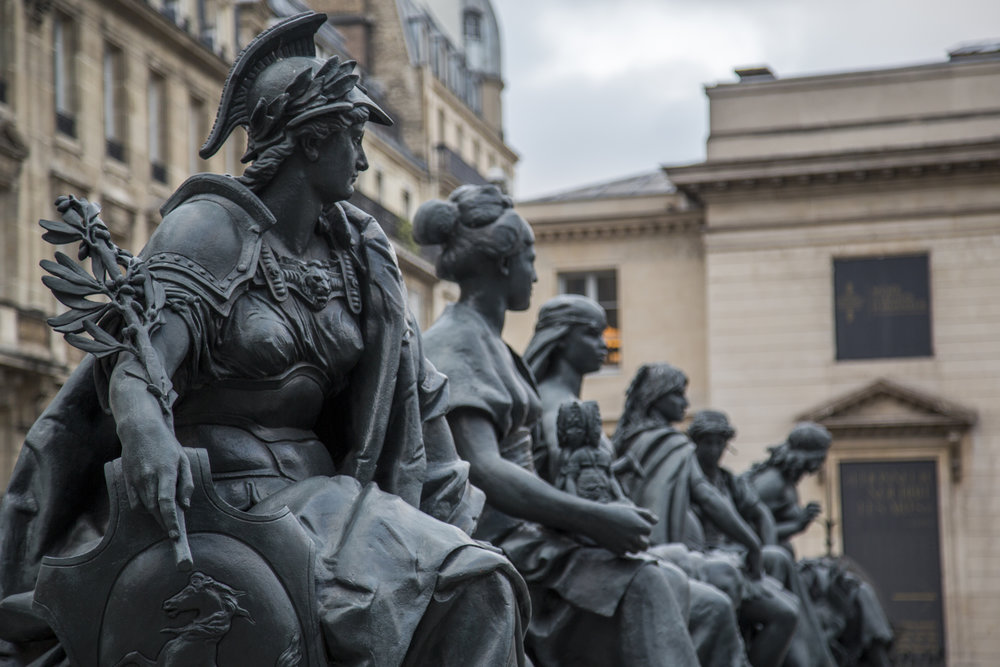 Statues line the entrance outside of the Musee D'Orsay in Paris, France.