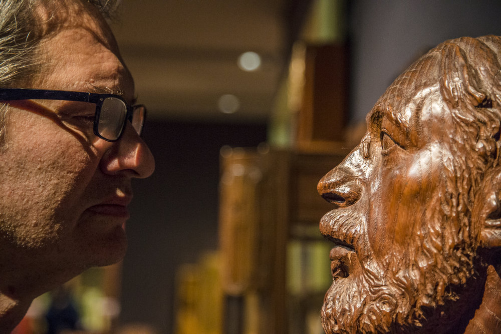 A museuam goer faces off with a statue at the Musee D'Orsay in Paris, France.