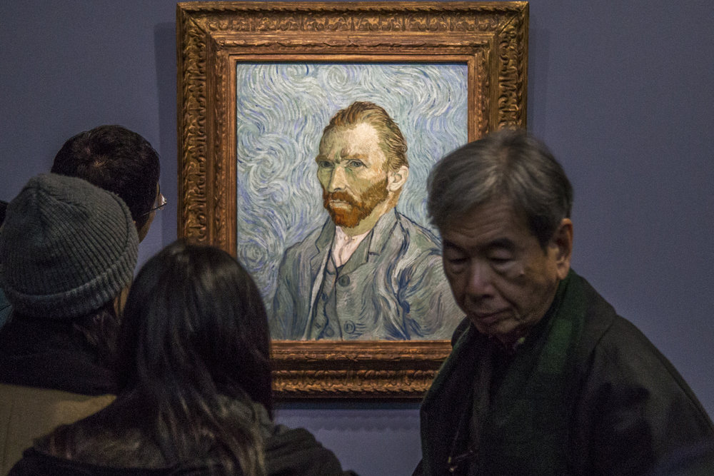 Guests of the Musee D'Orsay admire Vincent Van Vogh's famous self portrait in Paris, France.