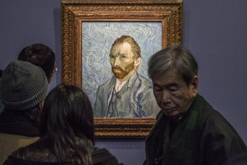 Guests of the Musee D'Orsay admire Vincent Van Vogh's famous self portrait in Paris, France.