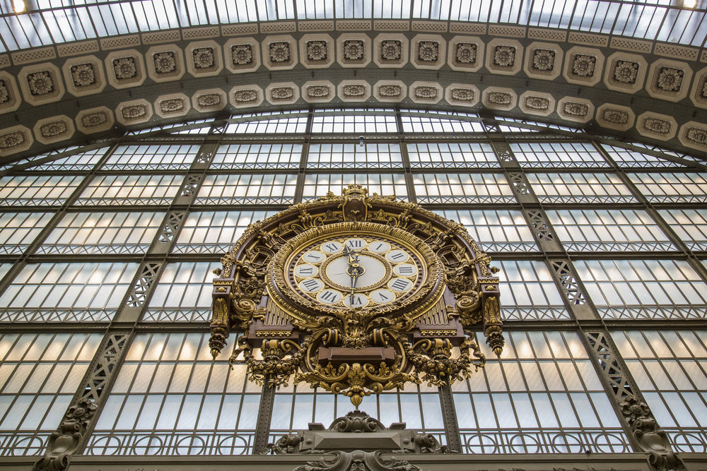 The Musee D'Orsay Clock by Victor Laioux sits high above the museum's main hall in Paris, France