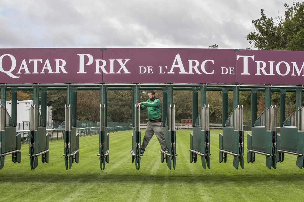 A groundskeeper prepares the starting gate prior to the 95th running of the Qatar Prix de L'Arc de Triomphe in Chantilly, France on Oct. 2 2016.
