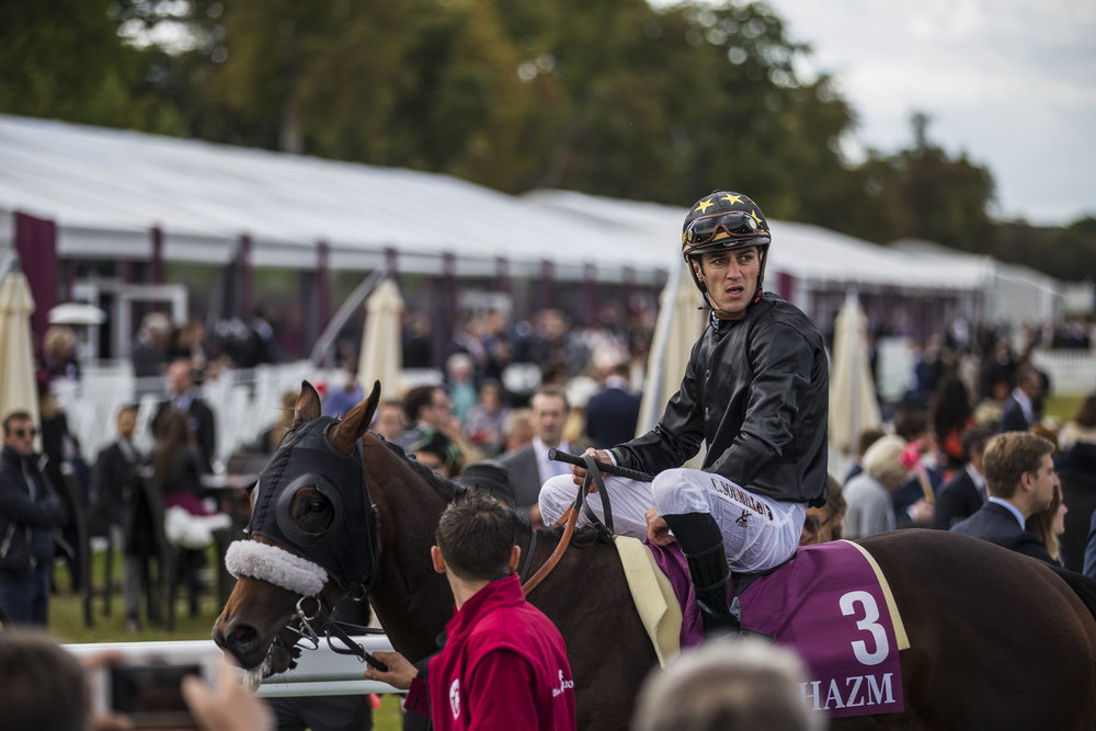 A jockey rides his horse off the track after a disappointing finish in an early race at the Qatar Prix de L'Arc de Triomphe in Chantilly, France on Oct. 2 2016.