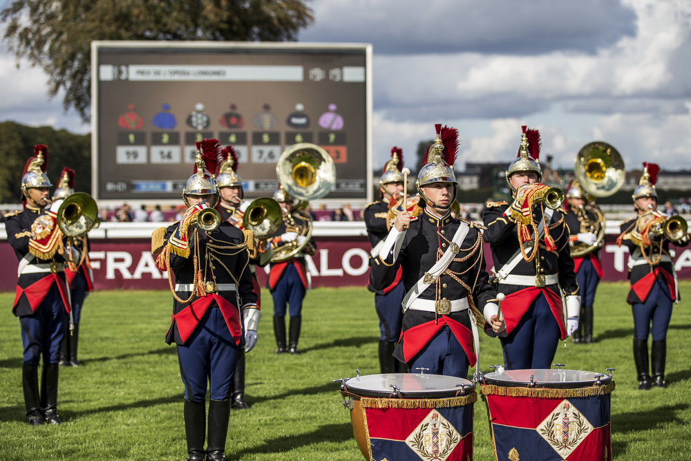 A military band plays on the track of the Chantilly Racecourse beween races at the Qatar Prix de L'Arc de Triomphe in Chantilly, France on Oct. 2 2016.