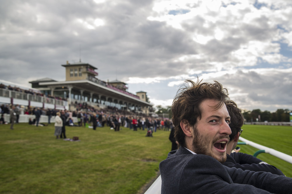 An attendee of the Qatar Prix de L'Arc de Triomphe reacts following a race in Chantilly, France on Oct. 2 2016.