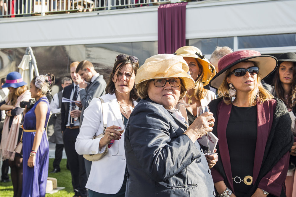 Attendees take in the races at the Qatar Prix de L'Arc de Triomphe in Chantilly France on October 2, 2016