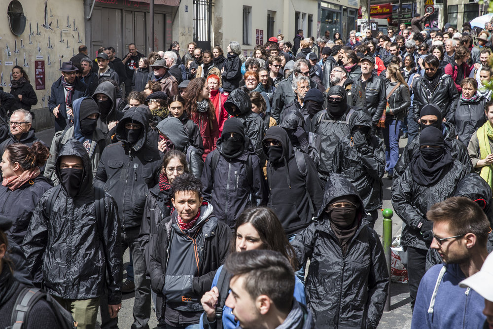 Members of Paris' anti fascist  black bloc join in with trade union groups as they march from Place des Fetes to Republique for International Worker's Day in Paris, France on May 1, 2017.