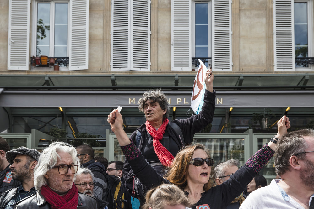 Supporters of Jean Luc Melenchon's left wing France Insoumise, or France Unbowed, party react with adulation after a surprise appearance by their leader in Paris, France on May 1, 2017.