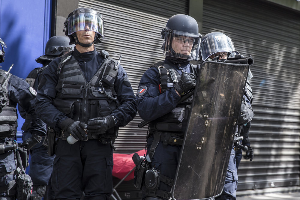 Members of Paris's riot squad police force attempt to fortify their position during riots that broke out during the May Day protests in Paris, France on May 1, 2017.