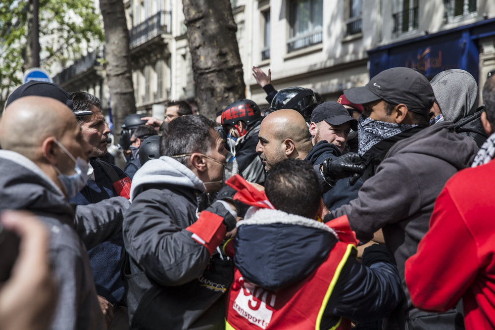 Heated arguments break out between members of the black bloc and peaceful protestors who attempted to quell the violence by getting in between rioters and police in Paris, France on May 1, 2017.