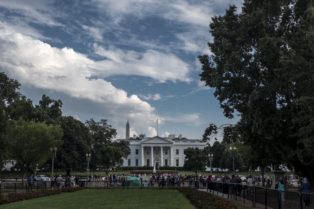 The White House from Lafayette Park where protestors begin to gather on the eve of the Unite The Right 2 rally.