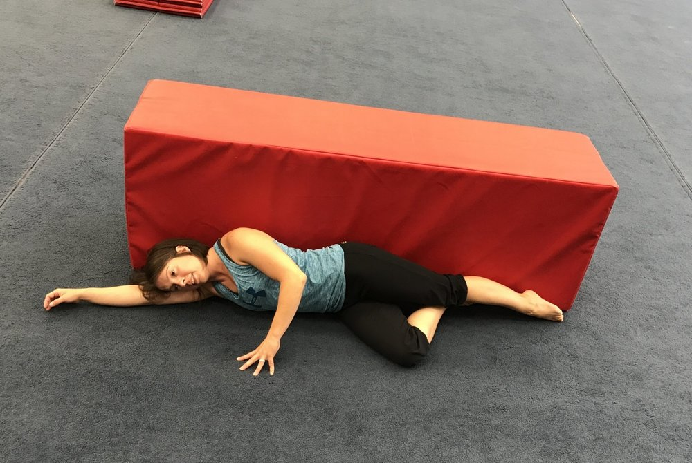 Starting position: Lying on your side with a wall/mat behind you to cue for form. Bend the bottom leg and be certain to keep the hips perpendicular to the floor (or slightly tilted forward). Top leg is straight with the hip as extended as possible and the toe is slightly turned down.