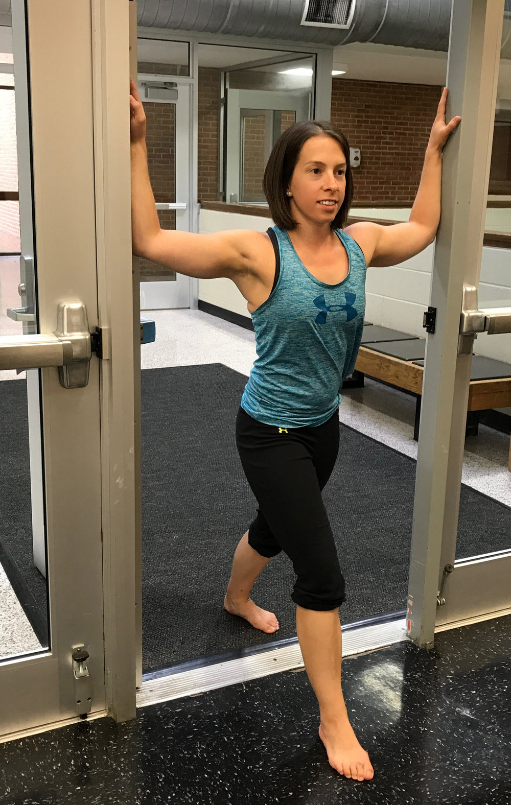 "Starting position:  Standing in a doorway, place the arms at 90 degrees of shoulder abd with about 90 degrees of elbow flexion.  Place one foot forward (for support).  Head and chest neutral with the abdominal muscles engaged (to protect the back).  Then shift the weight forward as if ""stepping through the door.""  You should feel a stretch across the front of the chest and arms."