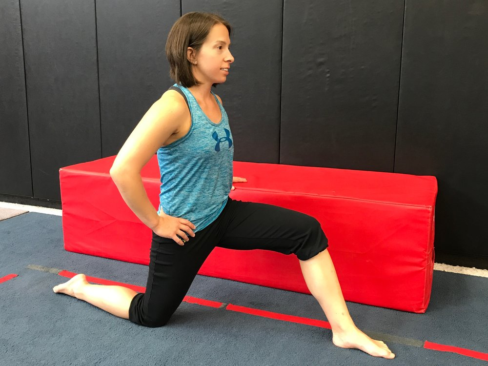 Kneeling in a lunge, with the bottom knee on a soft surface, flatten the low back by engaging the abdominal muscles.  Then shift the weight forward until a stretch is felt in the front of the hip of the down leg.  Be sure as you are lunging forward that 1) the front leg is sufficiently forward to ensure that the knee stays behind the toe and 2) the low back DOES NOT ARCH.  You'll notice that you don't have to lean much to engage the stretch - so be careful not to lose the core control!
