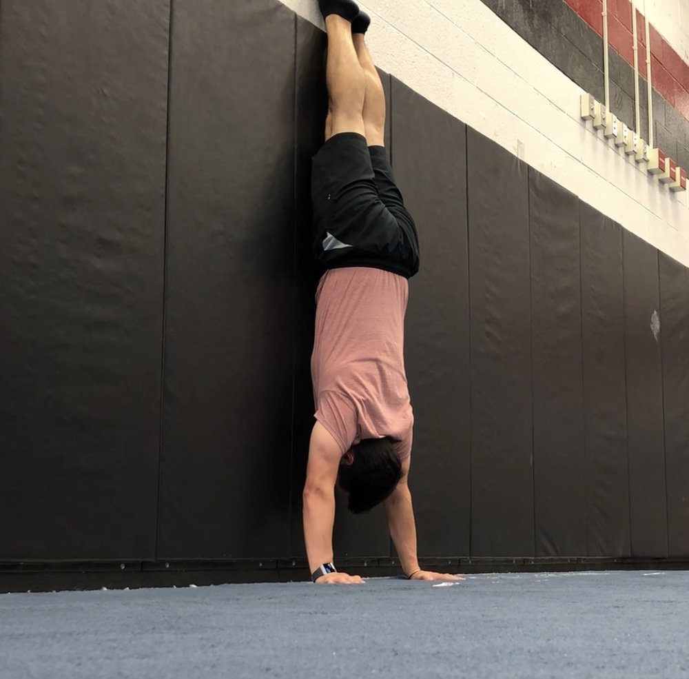 handstand training how to do a handstand wall walk and 4 reasons