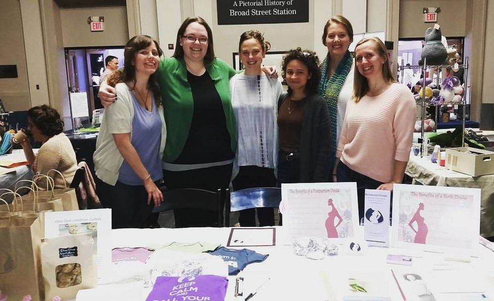 Womaning the Richmond Doula table at a Baby and Birth Fair.