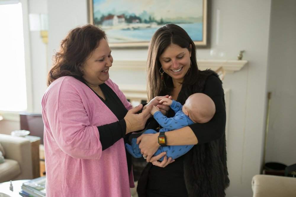 Richmond doula member and postpartum doula  amy washington  with a new family, photo by  joy kraynak of joyful birth services