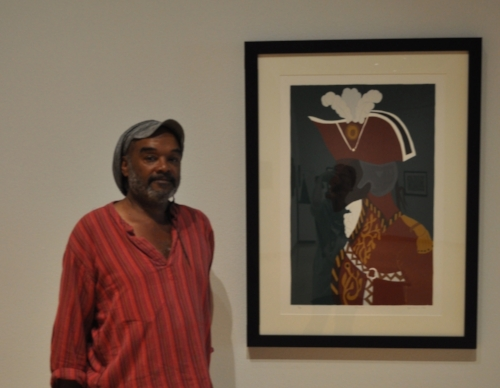 Ealy Mays in front of a picture by Jacob Lawrence of Toussaint-Louverture at the African-American Museum, Los Angeles, California, 2017