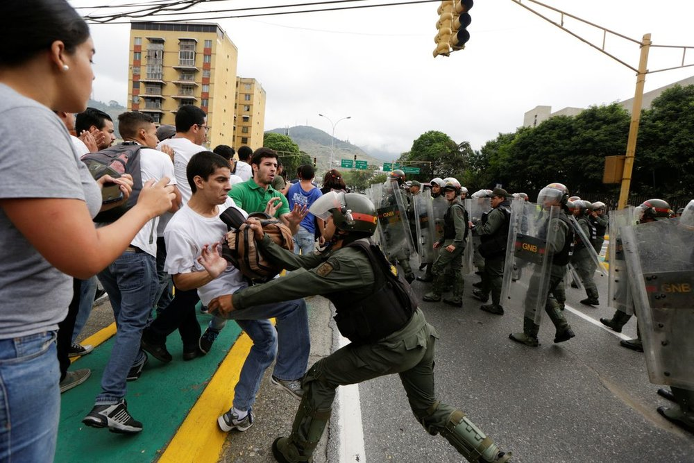 Opposition supporters clash with Venezuela's National Guards during a protest against President Nicolas Maduro's government outside the Supreme Court of Justice in Caracas. Source: Reuters