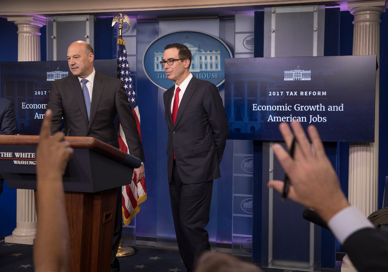 Gary D. Cohn, left, the director of the National Economic Council, and Steven Mnuchin, the Treasury secretary, at a White House briefing. CreditStephen Crowley/The New York Times