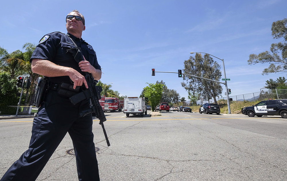 A San Bernardino Police Officer Stands Ready to Serve & Protect Following The San Bernardino School Shooting. Source: ABC