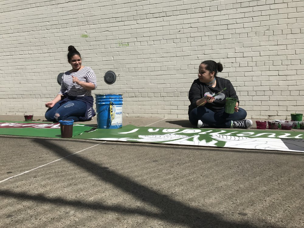 SFE students also helped with the banner painting!