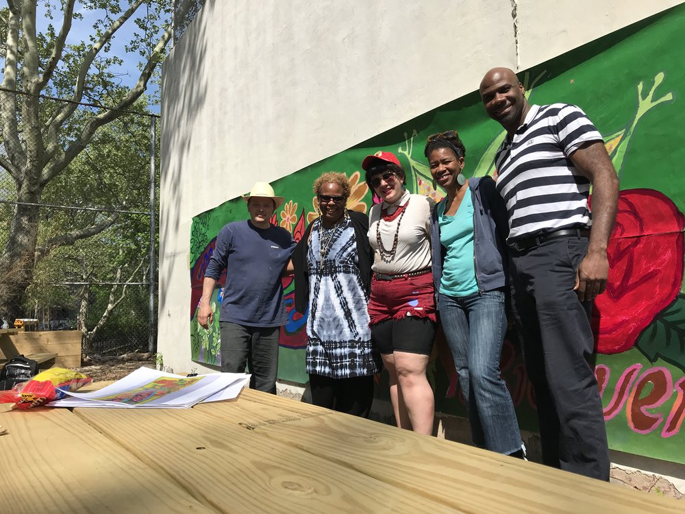 The Morris Campus Mural and Farm teams in front of the painted banner! From left to right: Josh Sarantitis, Carmen Bardeguez-Brown, Mikaela González, Mayfield Brooks, and Aaron Hargrove