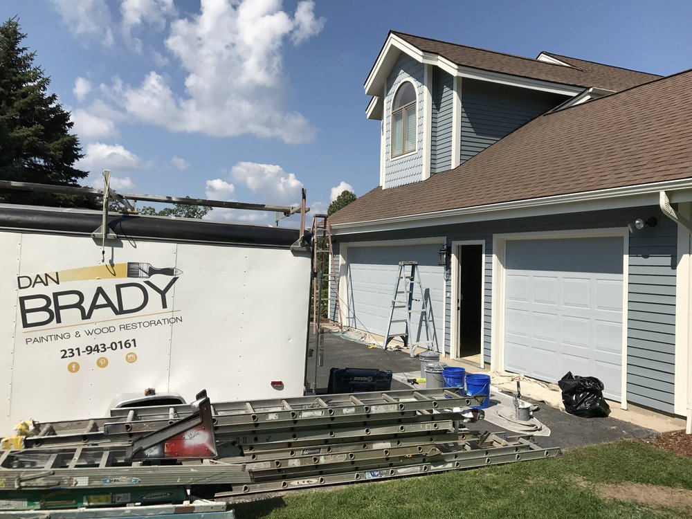 Painting house exteriors is a primary service of Dan Brady Painting & Wood Restoration in Traverse City.