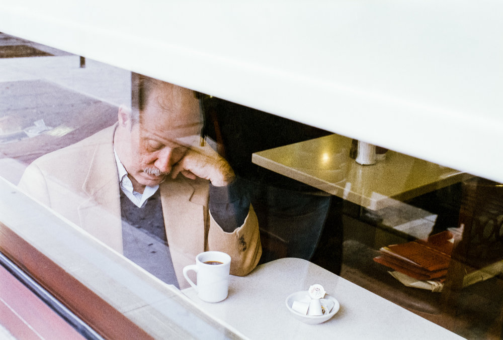 street photography downtown brooklyn project old man drinking coffee fuji x-tra 400 window day elan 7 50l